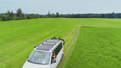 Small camping van with bike rack on country road Live Action