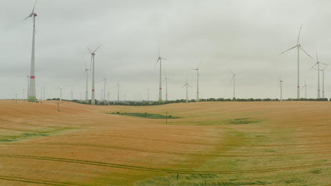 AERIAL: Wind Turbine rotating by the force of the wind and generating renewable Live Action