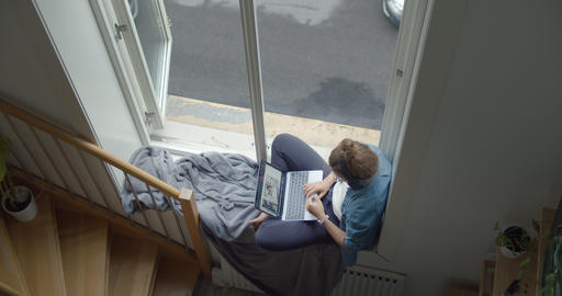 Young woman on staycation and window balcony Live Action