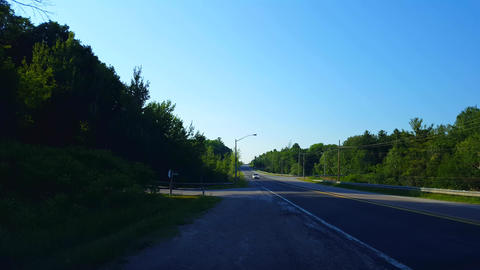 Viewpoint of Approaching Motor Vehicle From Side of Road in Summer. Roadside View of Incoming Live Action