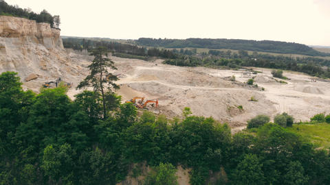 Large industrial sand quarry. Equipment that works in a sand quarry. The Live Action