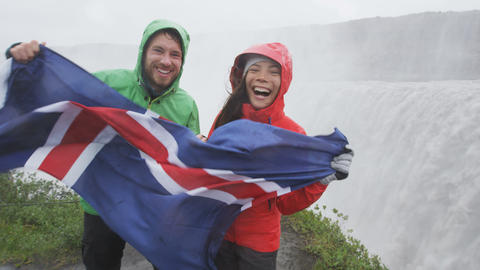 Travel couple fun by Dettifoss waterfall Iceland Live Action