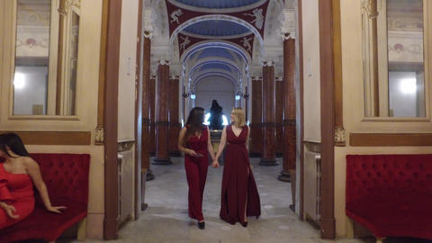 4K beautfiul girls walking into opera theatre with couple in the background Live Action