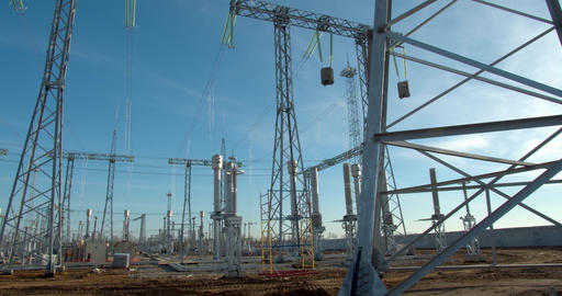 Huge metal structures with power lines, wind power plant construction site, 4k Live Action
