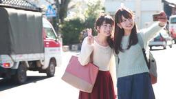 Young Japanese women taking a selfie in Kawagoe, Saitama Prefecture, Japan Footage