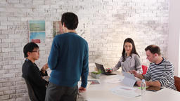 Multi-ethnic young business people working together in a modern office GIF