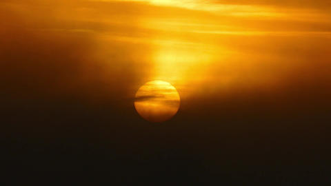 Sun rising in fog, telephoto 4k Footage