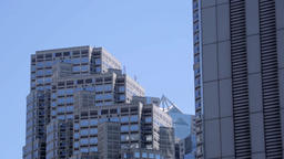 Low-angle view of Nishi-Shinjuku business district on a sunny day, Tokyo, Japan Footage