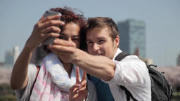 Caucasian young couple taking selfie in Tokyo Footage