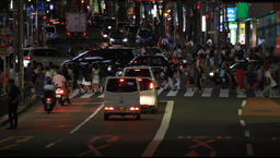 Cinematic shot of vehicle and pedestrian traffic in Shibuya district at night, T Footage