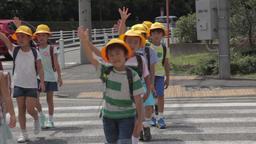 Japanese kids crossing the street Footage