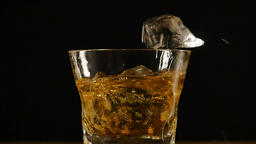 Ice cubes falling in a glass of whiskey Footage
