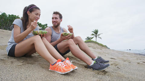 Salad - healthy fitness couple eating food Live Action