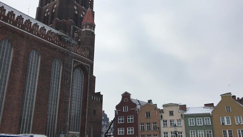 Gdansk, Poland, A large clock tower towering over a city Live Action