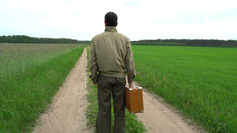 lonely man confused, in doubt, standing beside country road, life way, holding Live Action