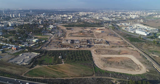 Aerial view over Israel open fields with traffic roads and agriculture view Live Action
