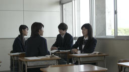 Japanese high-school students talking in the classroom Footage