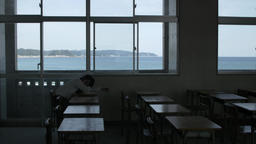 Japanese high-school student sleeping in an empty classroom Footage