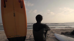 Japanese surfer looking at the sea from the beach, Chiba Prefecture, Japan Footage