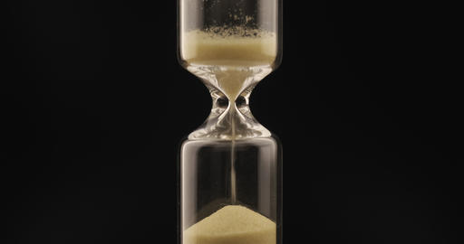 Sand falls through a bottleneck In a hourglass Live Action