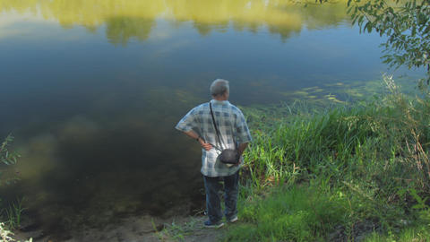 retired man observes beautiful nature with river and forest Live Action