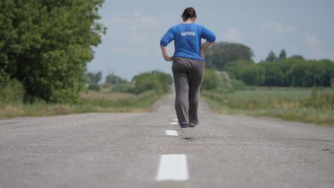 An asphalt road. Movement along the road marking line Live Action