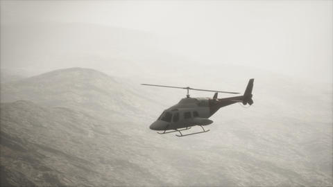 extreme slow motion flying helicopter near mountains with fog Live Action
