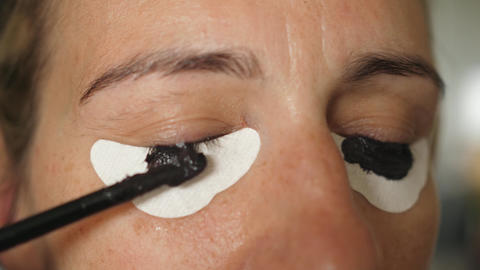dyeing eyelashes with henna apply applying with eye protection paper Live Action