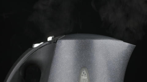 Slow motion. Boiling an electric kettle. Boiling water, steam and turning off Live Action