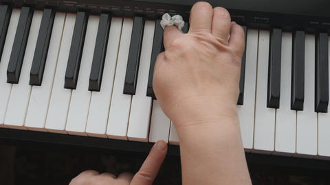 Electronic piano. Fingers press the piano keys. Care for the keyboard of a Live Action