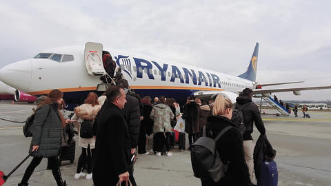 Budapest, Hungary airport tarmac passengers outside a Ryanair aircraft Live Action