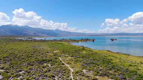 Aerial view of Mono Lake with tufa rock formations during summer season, Mono Live Action