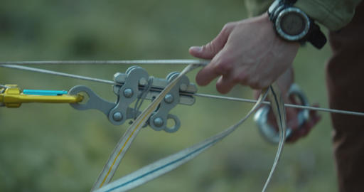 Fastening of the slackline cables, close up of the man preparing, 4k Live Action