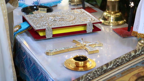 the priest's hand baptizes a cup of wine ライブ動画
