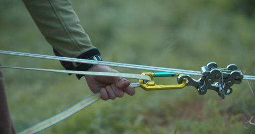 Close up of a man fastening the slackline cables, preparation, 4k Live Action