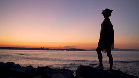Silhouette of women at the beach at sunset during golden hour. Fun and Live Action