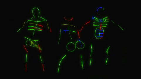 Art design disco dancers dancing in UV light. Night club, Party. 4K UHD video Live Action