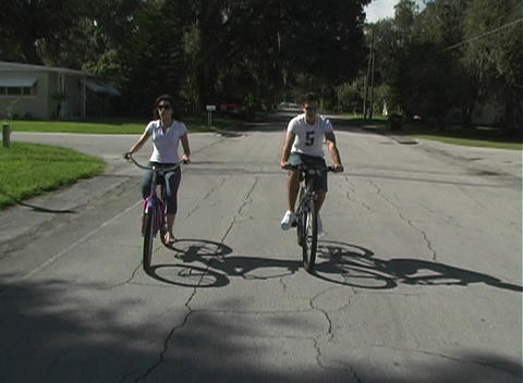 Couple Riding Bicycles :30 Stock Video Footage