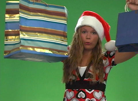 Beautiful Teen Girl with Shopping Bags and a Santa Cap Footage