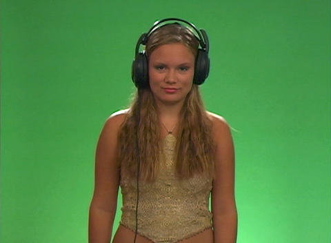Beautiful Teen Blonde with Headphones -2 Stock Video Footage