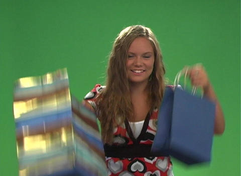 Beautiful Teen Blonde with Shopping Bags (2) Stock Video Footage