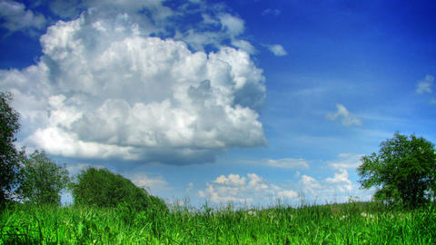 Clouds and grass time lapse hdr Stock Video Footage
