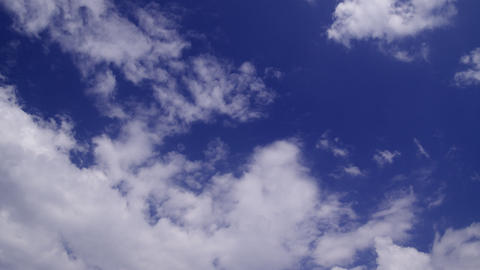 clouds covering a blue sky: timelapse Stock Video Footage