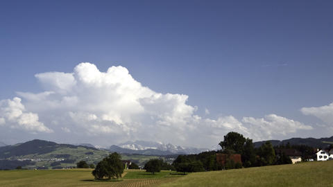 Storm clouds over hills and mountains: timelapse Stock Video Footage