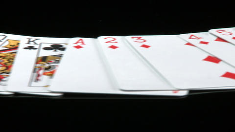 A deck of cards laid out rotates in front of a camera Stock Video Footage