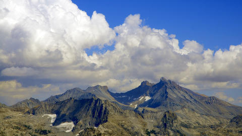 Time-lapse of clouds over the Western divide mountains in... Stock Video Footage