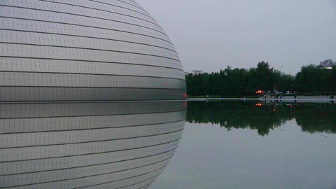 BeiJing China National Grand Theatre in reflection in lake water.ornate modern a Footage