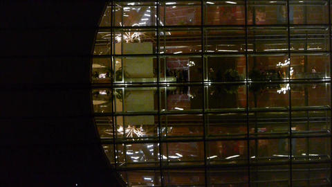 Tourists visit in BeiJing China National Grand Theatre glass house at night Footage