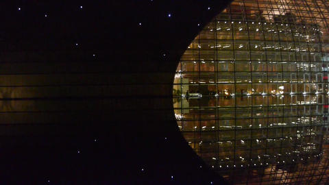 Zoom BeiJing China National Grand Theatre in reflection... Stock Video Footage