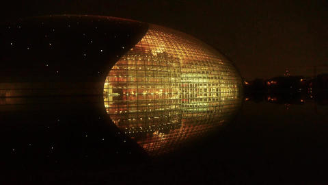 BeiJing China National Grand Theatre in reflection in lake water at evening nigh Footage